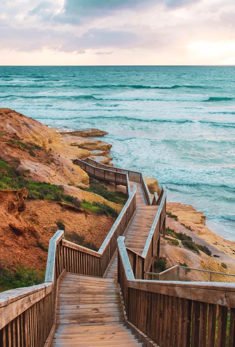 Image of walkway, rocky coast and ocean.
